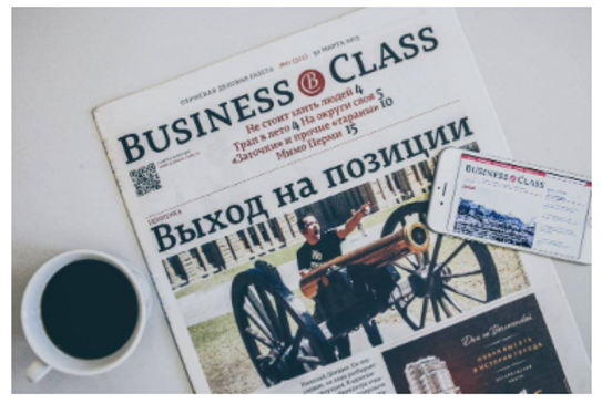 Business class newspaper.png