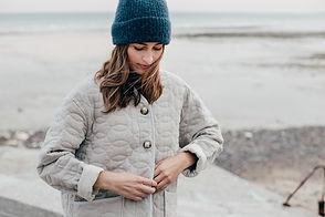 veste matelassée femme plage sable
