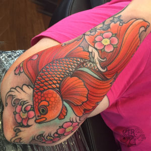 Goldfish and cherry blossom tattoo - link to Shannon Richmond's portfolio