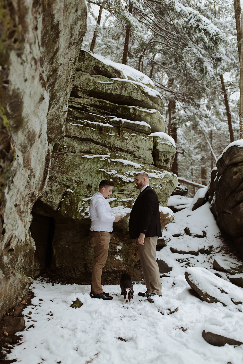 two groom reading vows on gay elopement