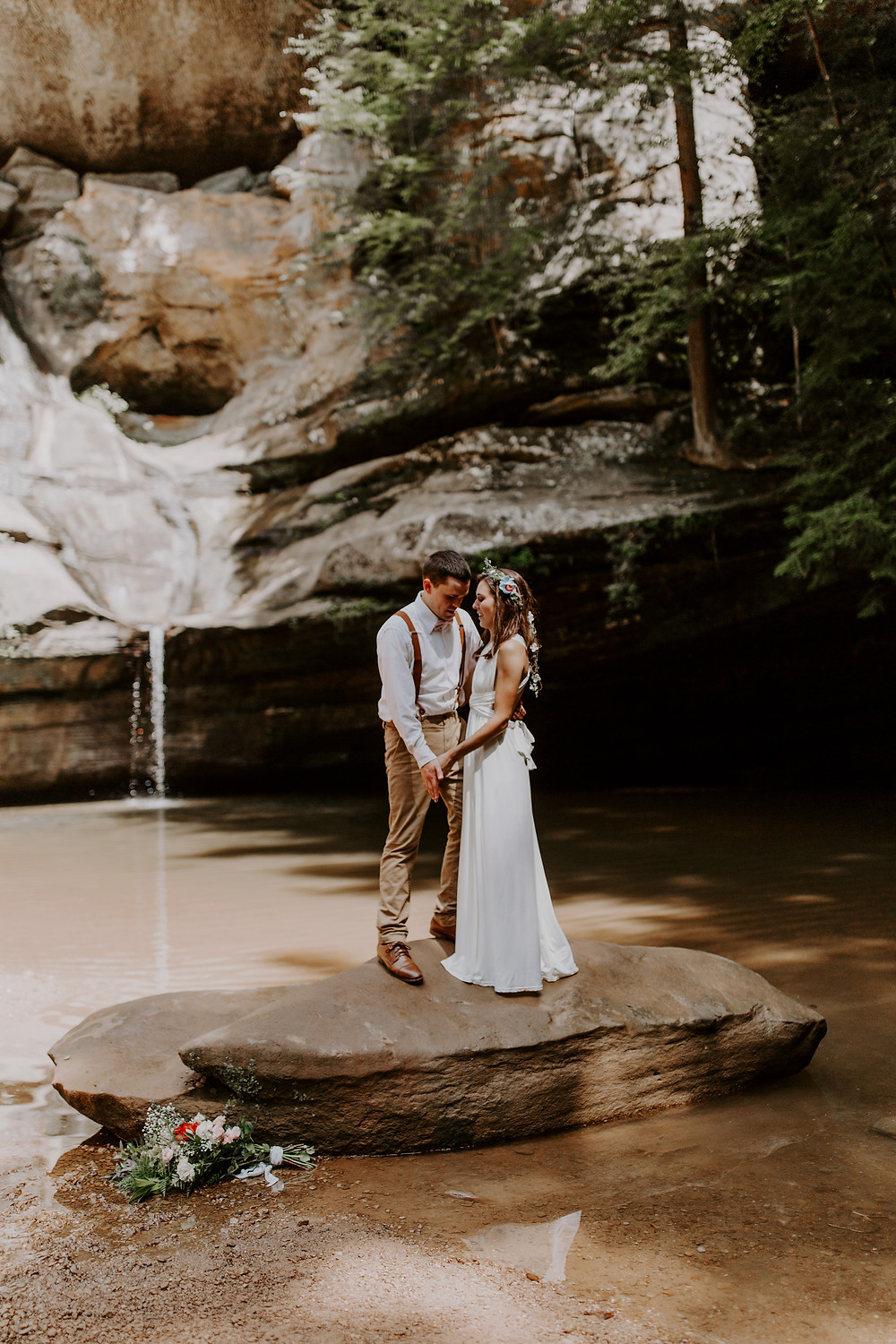 elopement at cedar falls in hocking hills Ohio couple in wedding attire facing each other