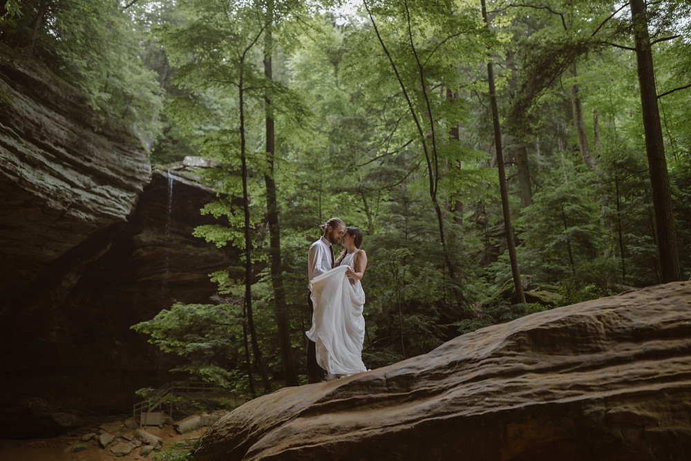 Couple eloping in front of Ash Cave in Hocking Hills Ohio