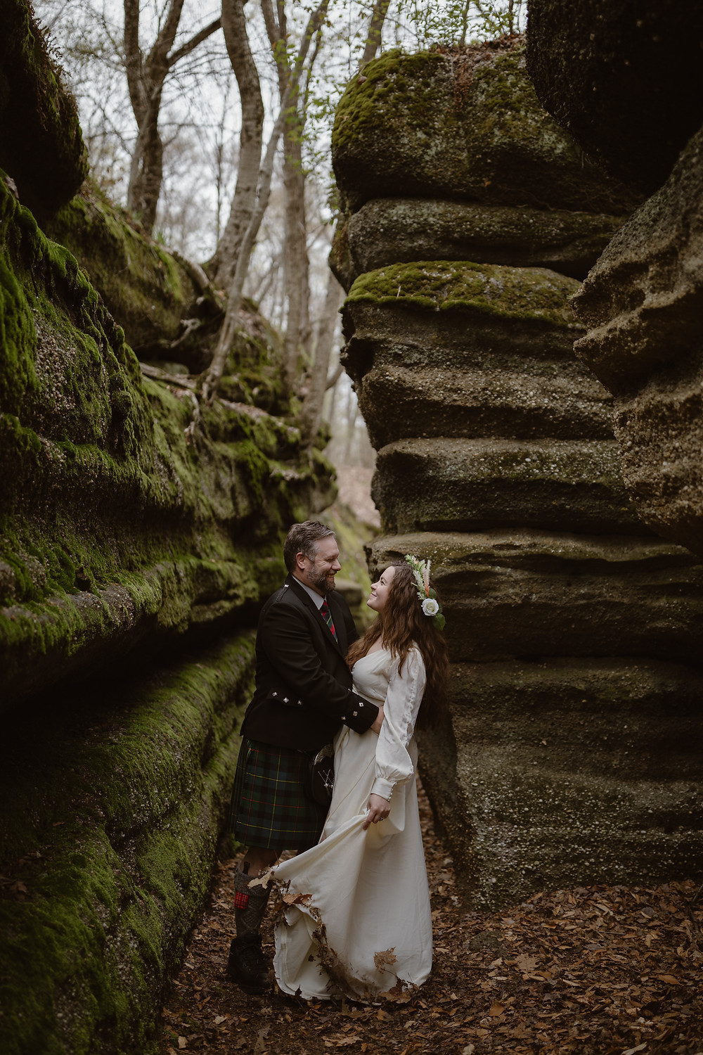 Couple on their elopement day in Ohio surrounded by the ledges of nelson Kennedy ledges state park.
