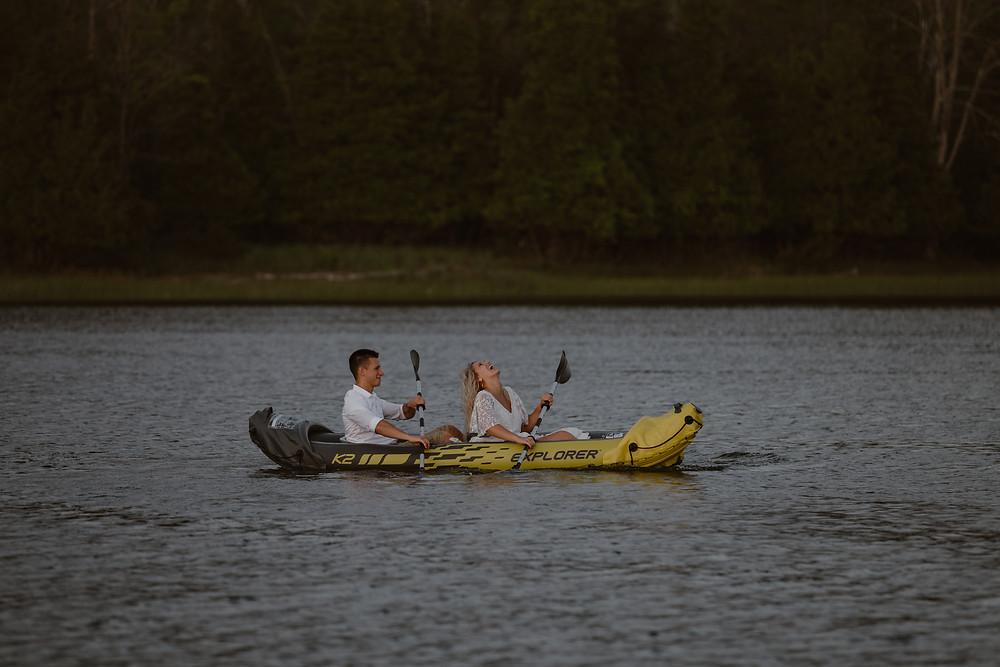 Couple kayaking in wedding attire