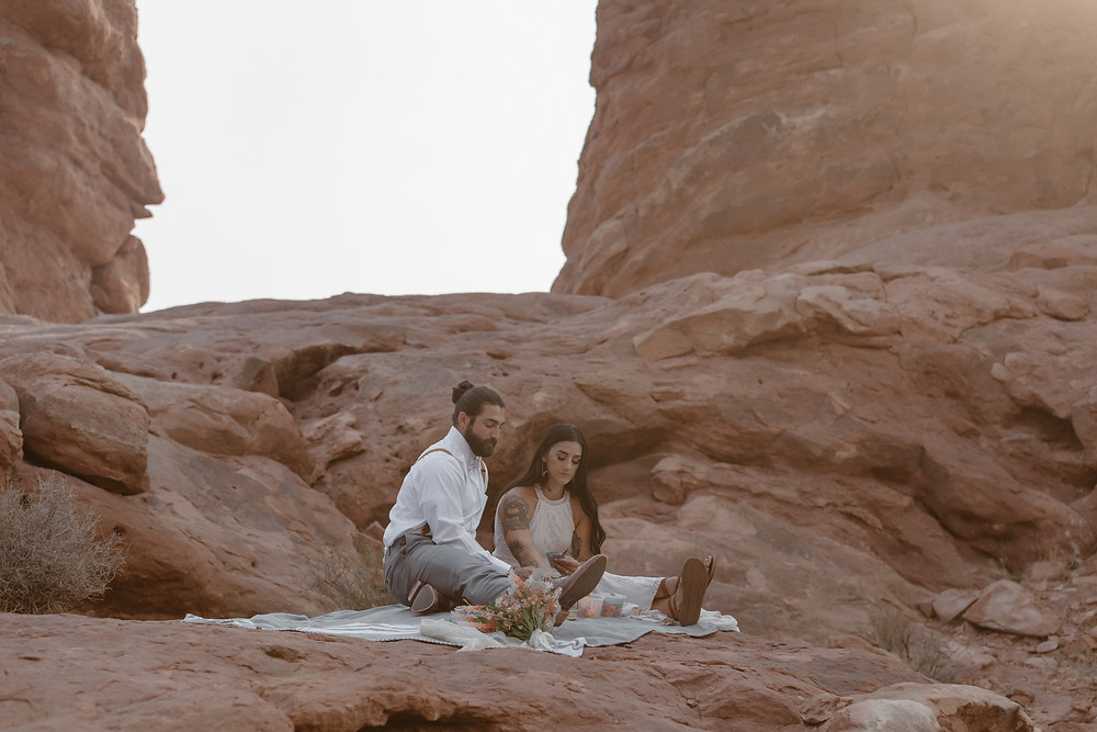 eloping couple and their toddler reading vows on their elopement in Colorado