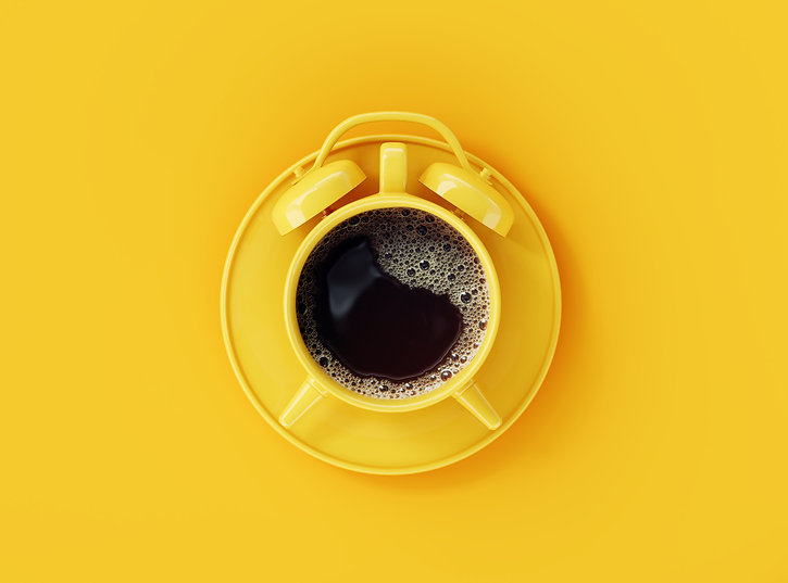 Coffee clock on yellow background. creat