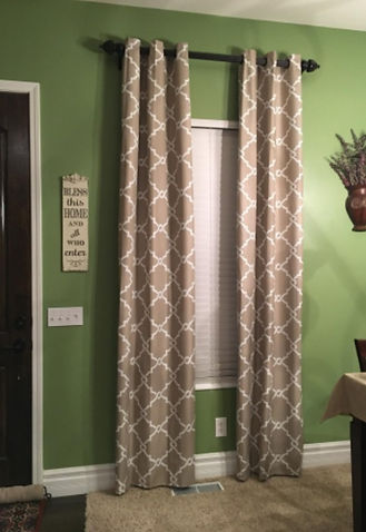 Newly installed curtains and blinds on a dining room window