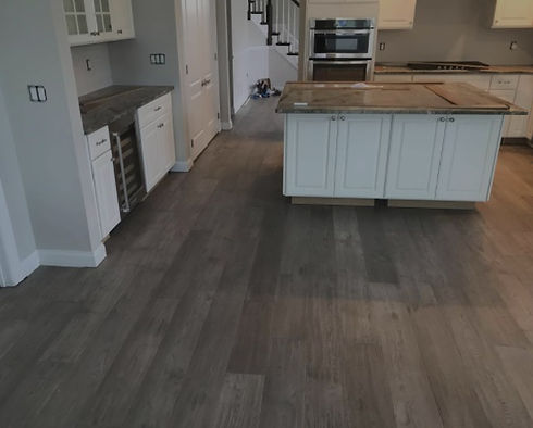 Newly installed flooring and cabinets in kitchen