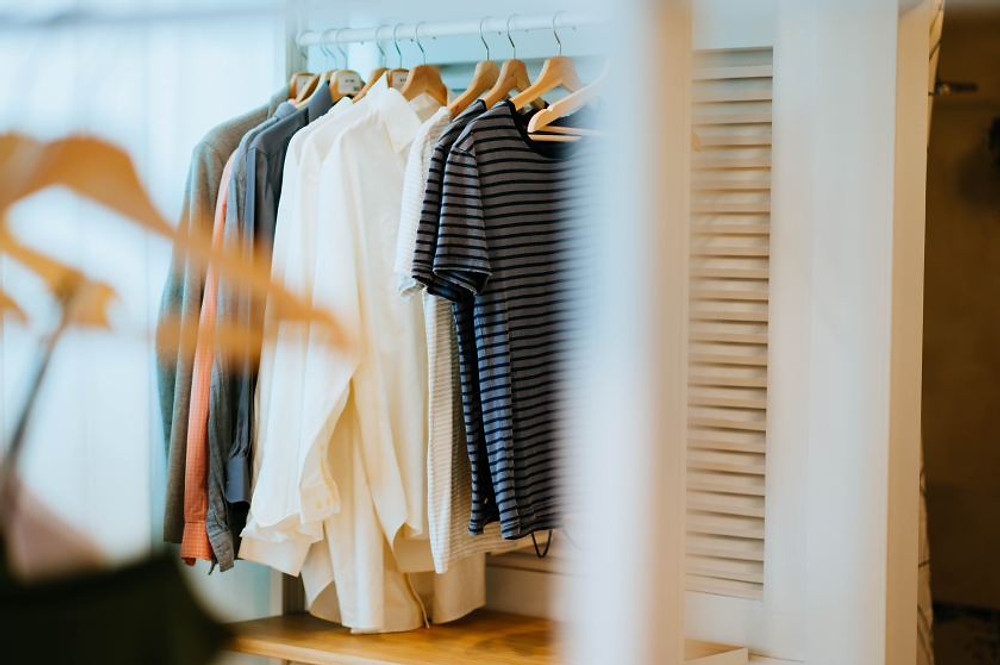 Various clothing on a rack