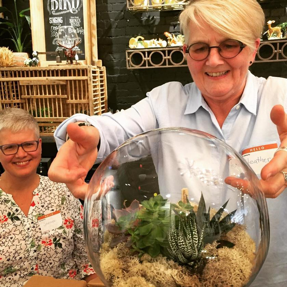 Older adults at a terrarium making workshop in Toronto