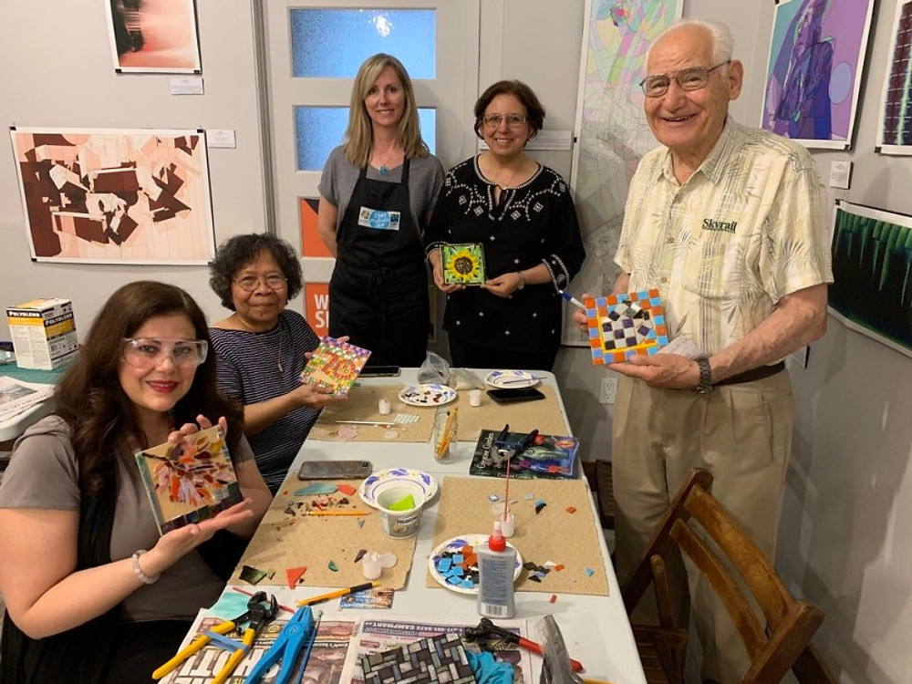 A group of older adults at a painting event in Toronto