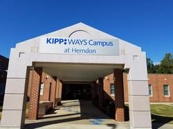 Giving out close at Kipp Academy