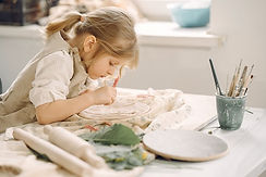 little-girl-makes-clay-plate-and-decorat