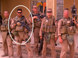 Photograph of GySgt Josh Negron with his team during a combat deployment