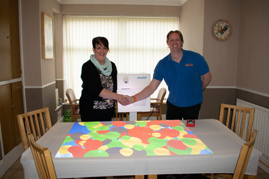 Residents at Tudor Lodge enjoying their new Mobii interactive table - Thank you Omi!