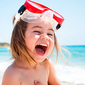 Photo - Child with snorkeling gear laugh