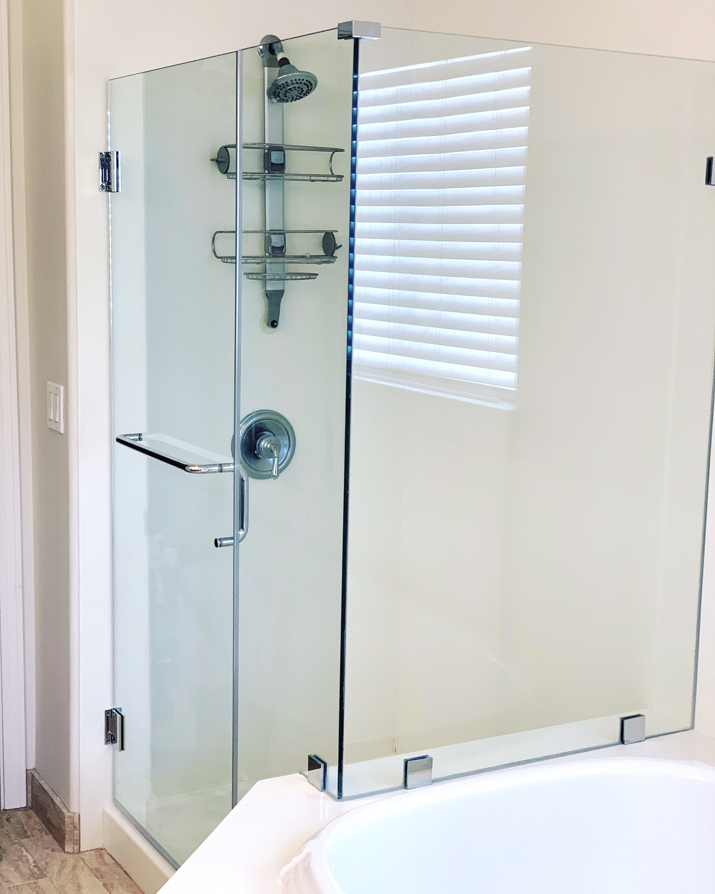 custom frameless 90 shower enclosure.