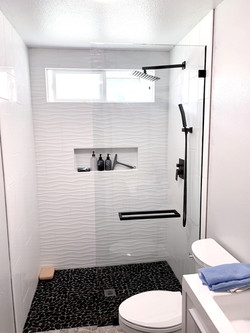 custom single panel with matte black glass clamps and towel bars.