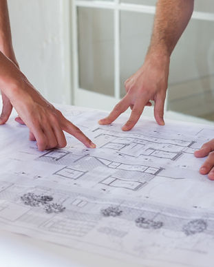architects-working-on-blueprints-together-in-the-office_13339-271745.jpg