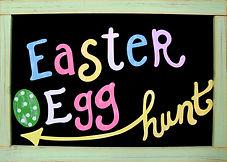easter egg hunt handwritten on board in