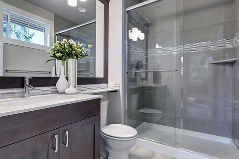 Bright new bathroom interior with glass