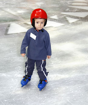 Young boy learning to skate.jpg