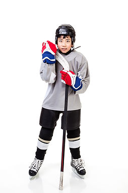 Junior ice hockey player with full equip