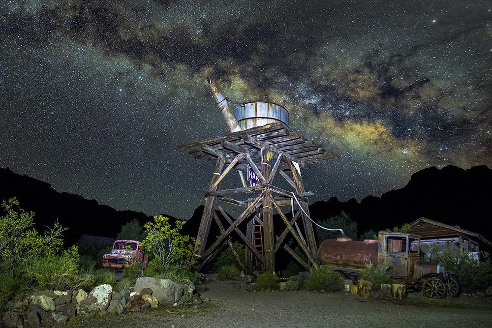 The Milky Way with a water tower in the foreground in ghost town