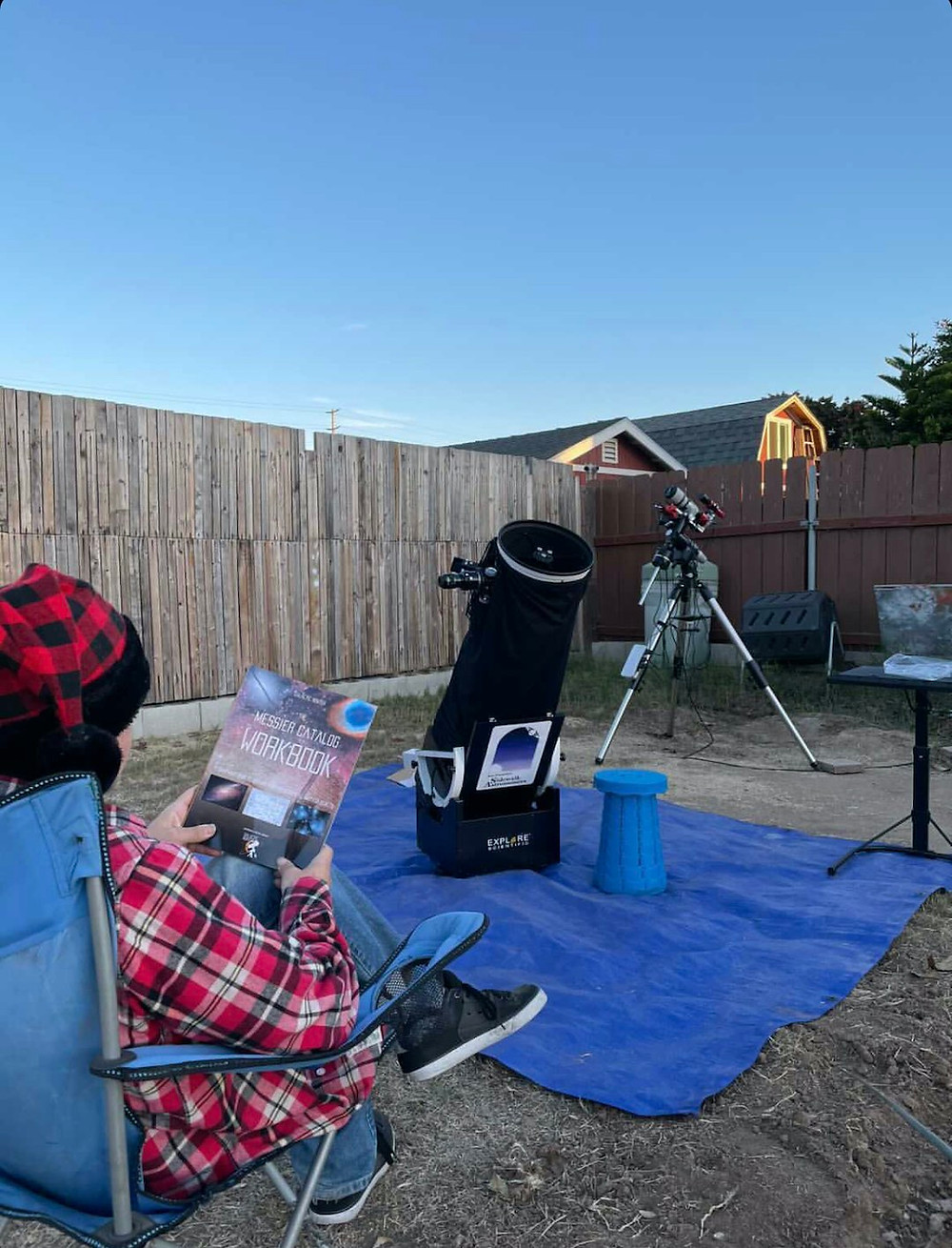 Astrophotography book in backyard with telescope