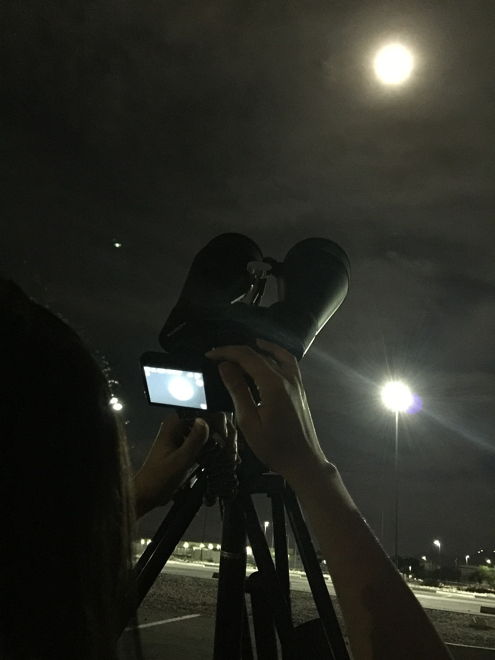 Photographing the Moon with a small point and shoot camera and Orion 20x80 astronomical binoculars