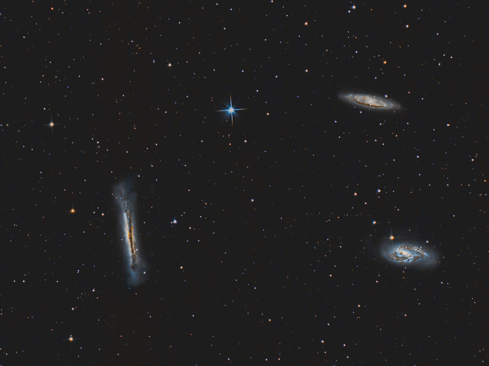 "Leo Triplet taken with an unmodified DSLR camera and an 8"" telescope"