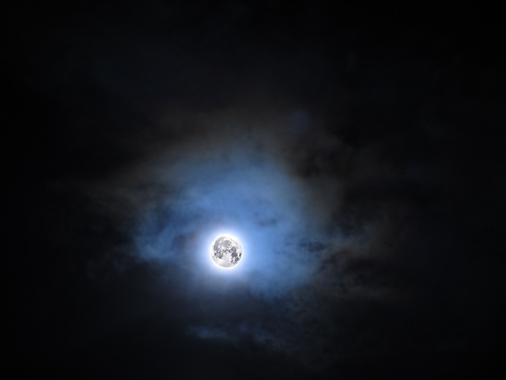 Full moon with blue clouds