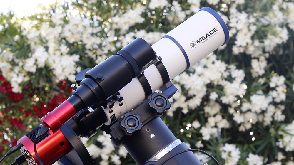 refractor telescope and flowers backyard
