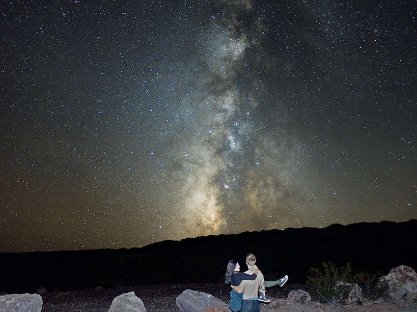 A couple in front of the Milky Way in Nevada