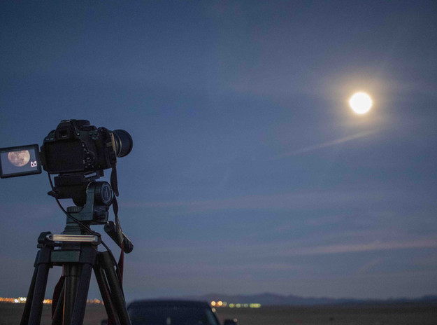 DSLR camera on a tripod shooting at the full moon Astrophotography