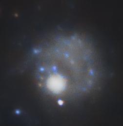 Galaxie Naine qui tire sur les bras de M101 avec sa force gravitationnelle.