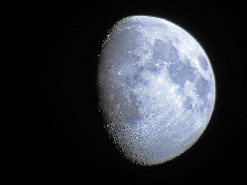 The Moon taken with a Canon point and shoot camera through a pair of Orion 20x80 binoculars from Orion Telescopes and Binoculars. Image taken in Las Vegas, NV