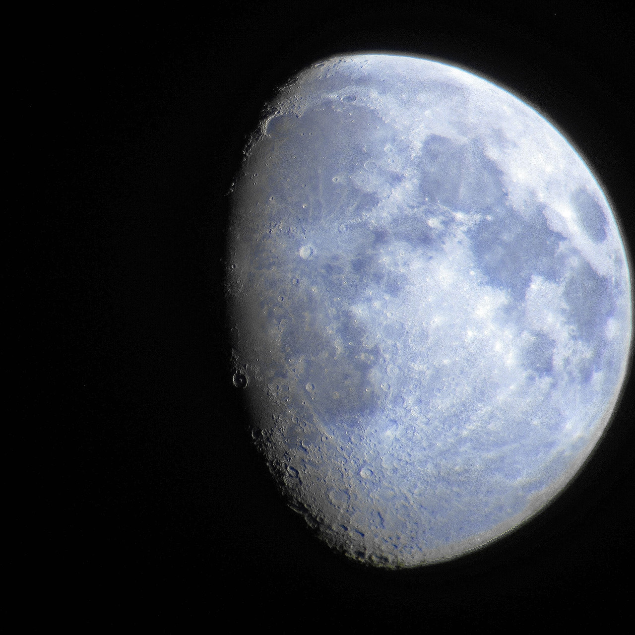 The Moon with a point and shoot canon camera and a 20x80 pair of Orion binoculars