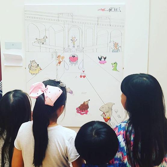 Children checking finished artwork I did