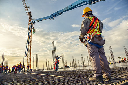 A construction worker control a pouring