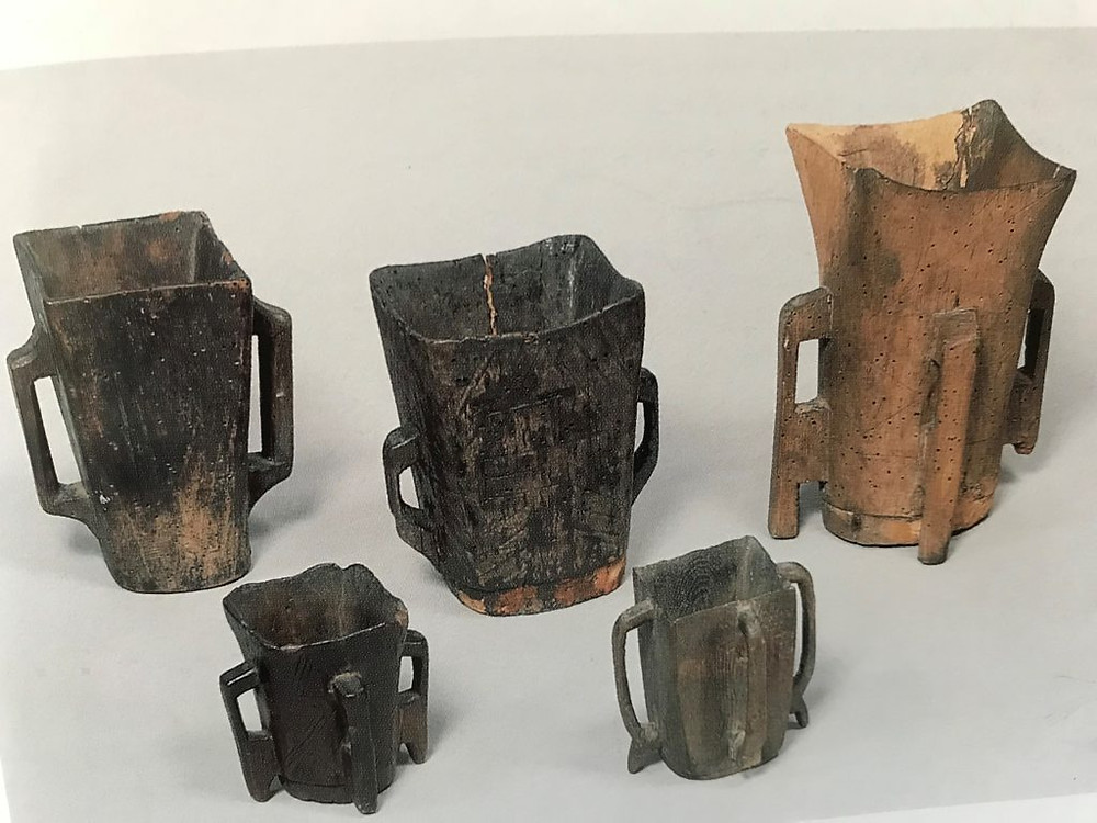 Wooden drinking vessels with either two or four handles. Carved from one block of wood