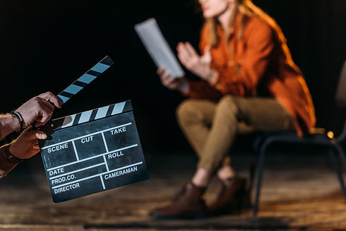 selective focus of actor with clapboard