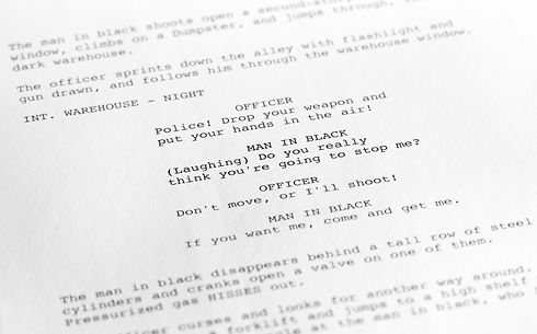 Close-up of a page from a screenplay or