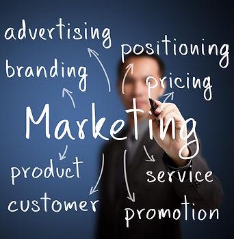 business man writing marketing concept.j
