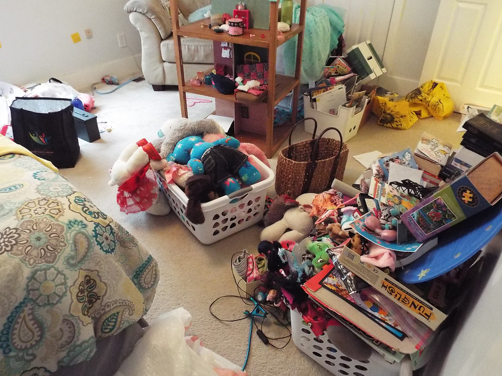 Everything taken out of the room being decluttered and orgnized and put in another room for a bit.