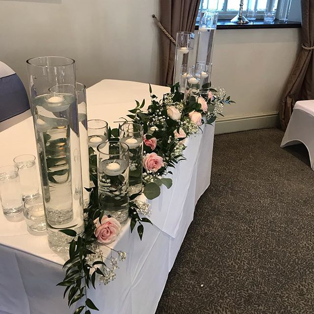 Cylinder vases with candles in lining th
