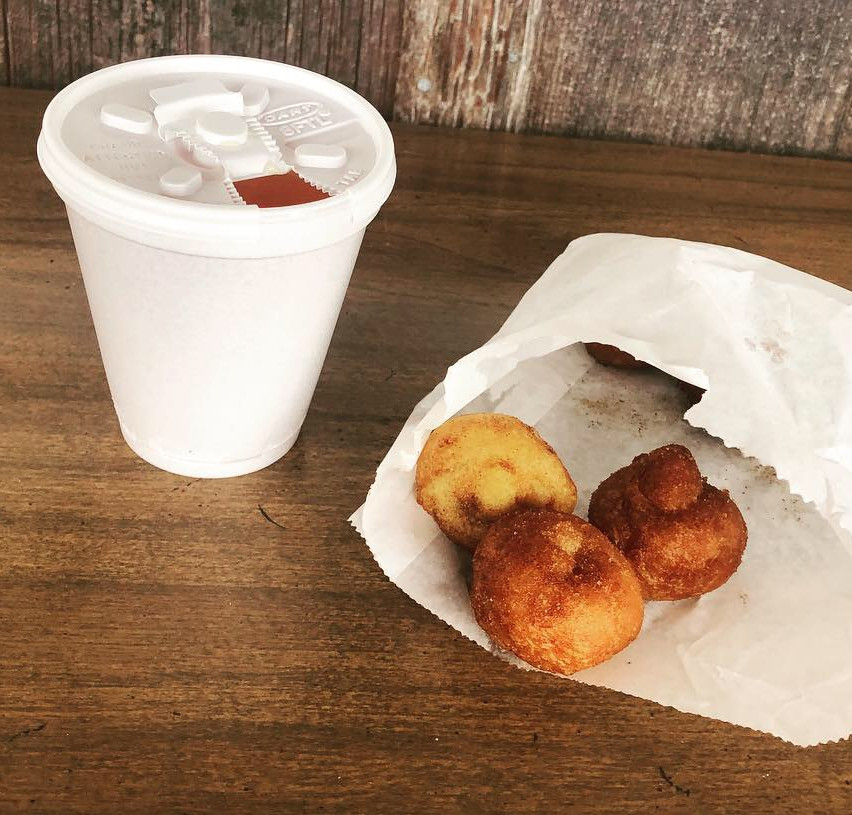 Happiness is hot apple cider with a side of cider donuts.