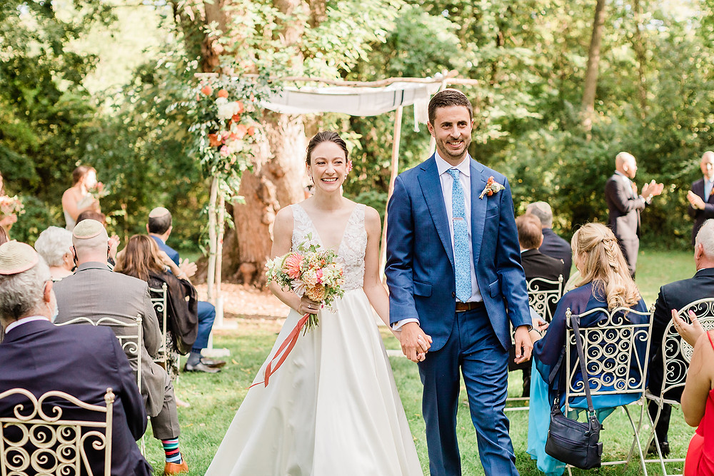 Bride and groom Recessional at Jewish Ceremony in Garden