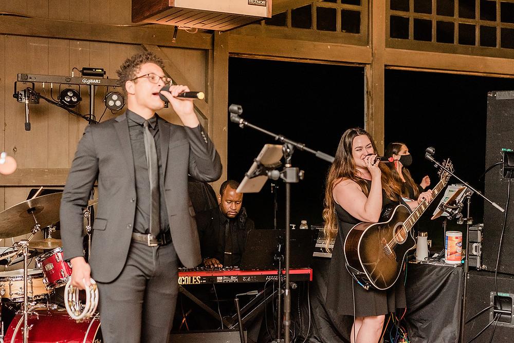 The Metropolitan Players, a wedding band, preforming at COVID wedding