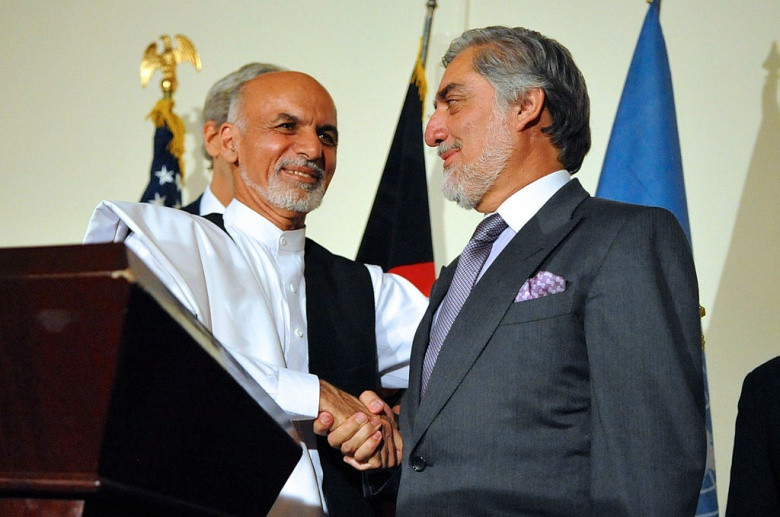 Image: Ashraf Ghani shakes hands with Abdullah Abdullah. Wikimedia Commons/U.S. Department of State